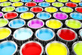 D render of colorful paint buckets background Stock Image