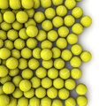 D render of tennis balls spilling on to white background Stock Photos