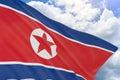 3D rendering of North Korea flag waving on blue sky