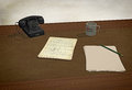 3D rendering: old fashioned still life, desk with vintage telephone and handwriting sheets Royalty Free Stock Photo