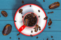 3d rendering top view of beans Soar out of a red coffee cup