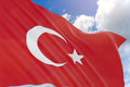 3D rendering of Turkey flag waving on blue sky background
