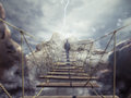 D rendering of unstable bridge man walks over a crumbling Royalty Free Stock Images