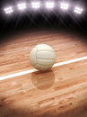 D rendering of a volleyball on a court with stadium lighting room for text or copy space Stock Photo