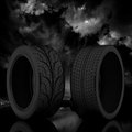 D tire on a dark sky background Stock Images