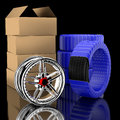 D wheels and tire box with tires in the background Royalty Free Stock Image