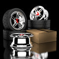 D wheels and tire box with tires in the background Royalty Free Stock Photo