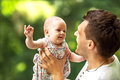 Dad and baby daughter playing in the park in love Royalty Free Stock Photos