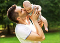 Dad and baby daughter playing in the park in love Stock Photo