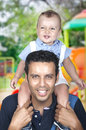 Dad carrying his son on shoulder father s shoulders having fun Royalty Free Stock Photo