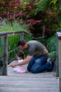Dad and daughter on a bridge Royalty Free Stock Photo