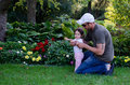 Dad and daughter  garden play Royalty Free Stock Photos