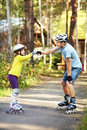 Dad and daughter in a helmet portrait of sports with his little on the skates two people rollerblade Stock Photography