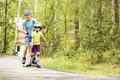 Dad and daughter in a helmet portrait of sports with his little on the skates two people rollerblade Stock Photos
