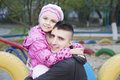 Dad and daughter hugging on the playground Stock Photo