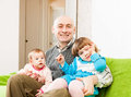 Dad and daughters on couch father two young at home Royalty Free Stock Images