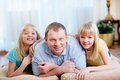 Dad and daughters portrait of a handsome father his lovely twin Royalty Free Stock Image