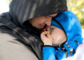 Dad hugging his sad son outdoor Royalty Free Stock Image
