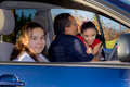 Dad hugs daughter at car before cheerleader practice Royalty Free Stock Photography