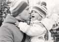 Dad kissing daughter and soothes outdoors black and white Stock Photography