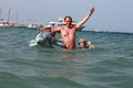 Dad and the little boy swimming near the toy Dolphin Royalty Free Stock Photo