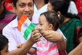 Dad little girl holding national flag father handing the of india to his daughter the tricolor it represents the indian tricolor Royalty Free Stock Images