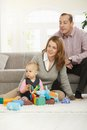 Dad mum and baby family fun daughter playing with toys at home Royalty Free Stock Image