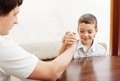 Dad play with child father and son arm wrestling Stock Images
