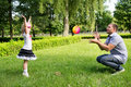Dad plays with her daughter with the ball Royalty Free Stock Photo