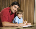 Dad and son with homework. Stock Photo