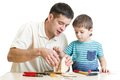 Dad and son kid make nesting box Royalty Free Stock Photo