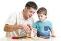 Dad and son kid make nesting box Royalty Free Stock Photo