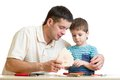 Dad and son kid teach building nesting box isolated Stock Images