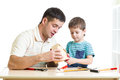 Dad and son kid work with building tools Royalty Free Stock Photo