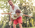 Dad and son resting outdoors Royalty Free Stock Photo