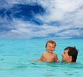 Dad and son swimming together Royalty Free Stock Image