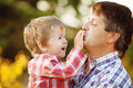 Dad and son walking in the park in summer handsome father his cute smiling together outside Royalty Free Stock Photos
