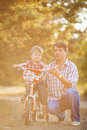 Dad and son walking in the park in summer handsome father his cute smiling together outside Royalty Free Stock Photo