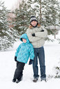 Dad and son walking in  winter park Royalty Free Stock Images