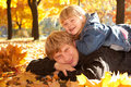 Daddy and daughter on autumn leaves Stock Photography