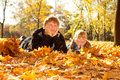 Daddy and daughter on autumn leaves Stock Image