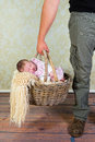 Daddy goes baby shopping holding an old wicker basket with his days old newborn Stock Photography