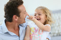 Daddy and his little girl playing together Royalty Free Stock Photo