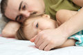 Daddy holding ailing baby hands lying together Royalty Free Stock Photo