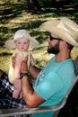 Daddy Holds Newborn
