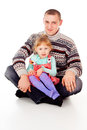 Daddy hugged the little girl, sit Royalty Free Stock Image
