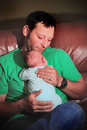 Daddy loves new baby a and cuddles his born shallow depth Royalty Free Stock Photos