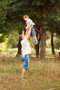 Daddy raising up the child happy father and son outdoors Royalty Free Stock Image
