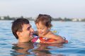 Daddy with a small daughter swimming in the lake an inflatable circle Stock Images