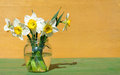 Daffodils In A Glass Vase On W...